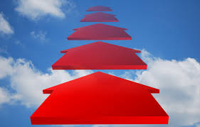 a row of red arrows pointing forward into a blue sky with clouds